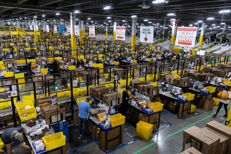 Image: Workers fulfill orders at an Amazon fulfillment center on Prime Day in Raleigh, N.C.,