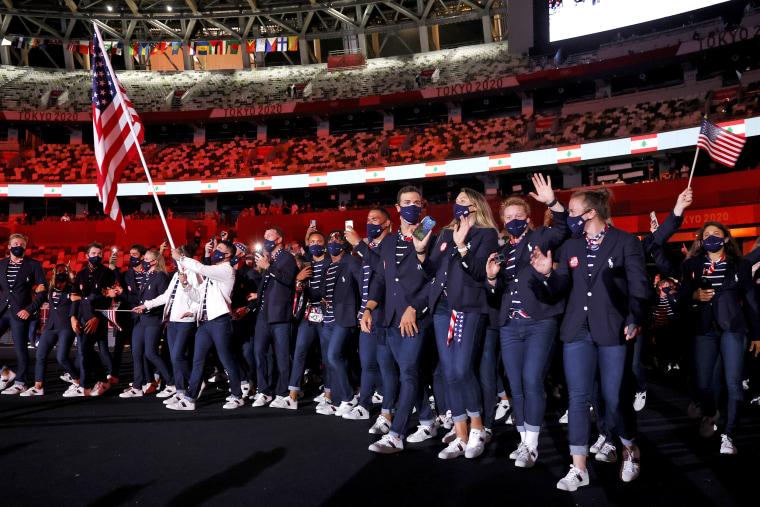 Flag bearers Sue Bird and Eddy Alvares of Team United States.