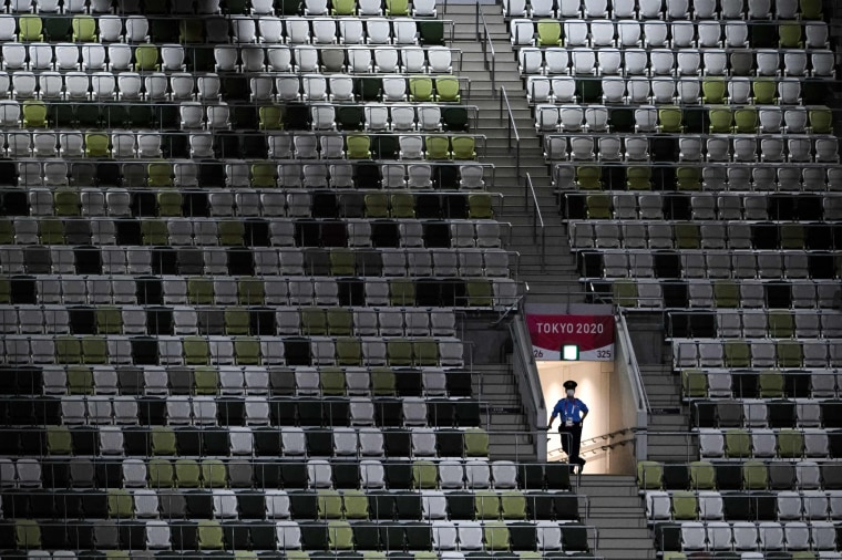 A police officer in the empty stands ahead of the ceremony.