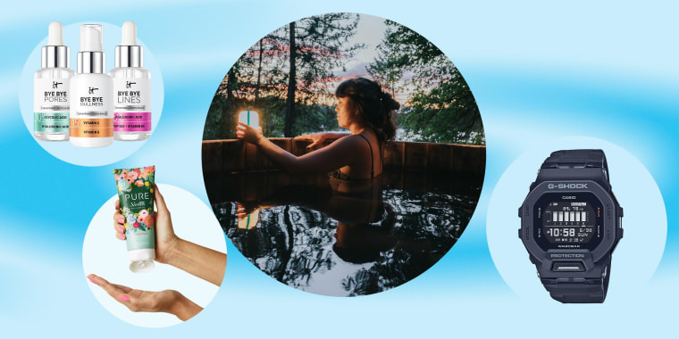 Image of a Woman in a hot tub in nature using her BioLite AlpenGlow lantern, three bottles from IT Cosmetics new serum collection, an hand holding a new shaving cream bottle Venus x Rifle Paper, and a watch from the G-SHOCK men's fitness line