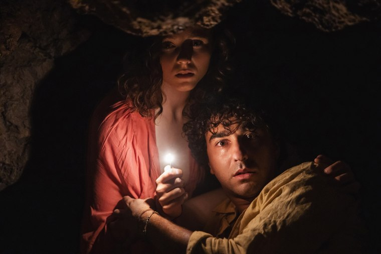 "Image: Thomasin McKenzie, left, and Alex Wolff in M. Night Shyamalan's movie \""'Old.\"""