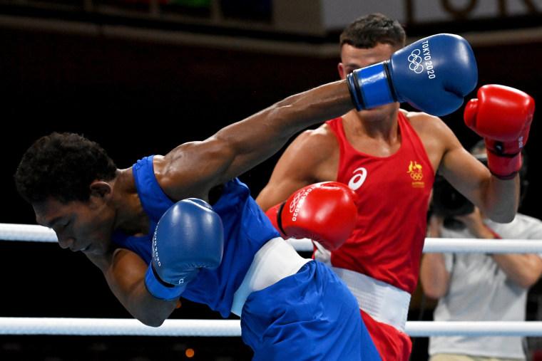 Australia's Harry Garside in action against Papua New Guinea's John Ume in the Men's Lightweight division at Kokugikan Arena in Tokyo on July 25, 2021.