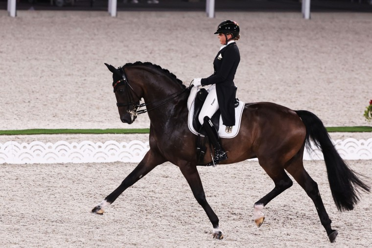 aGermany's Dorothee Schneider competes in dressage with her horse Showtime FRH at the Olympics on July 25, 2021, in Tokyo.