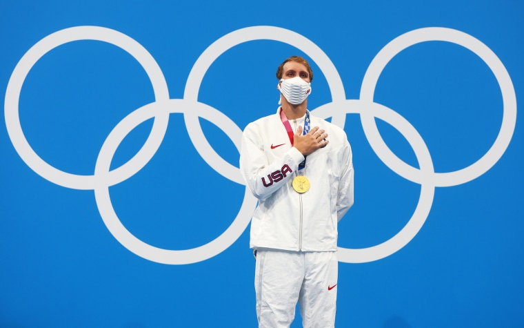 Gold medalist Chase Kalisz of the United States celebrates on the podium at the Olympics in Tokyo on July 25, 2021.
