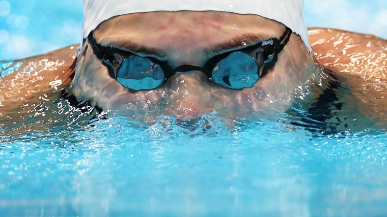 Lithuania's Kotryna Teterevkova competes in the Women's 100m Breaststroke on July 25, 2021, at the Olympics in Tokyo.