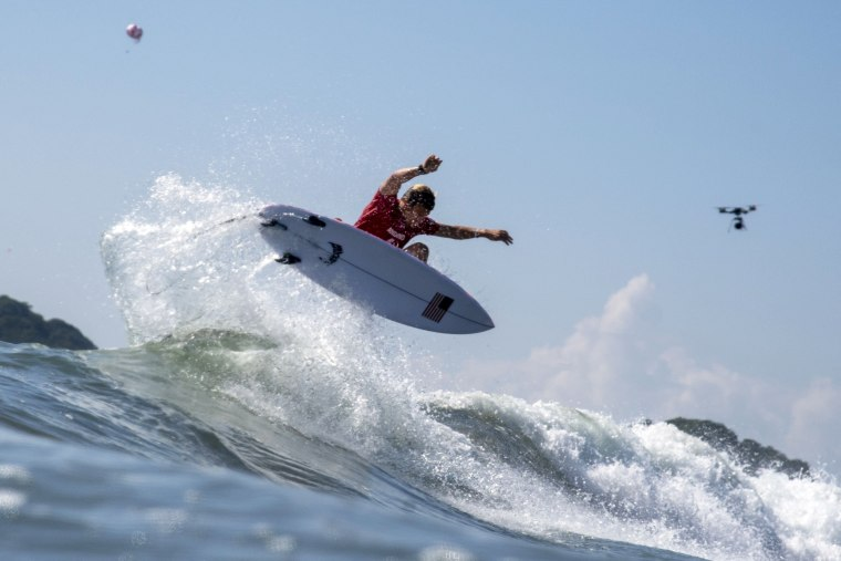 USA's Kolohe Andino rides a wave during the men's Surfing first round at the Tsurigasaki Surfing Beach in Chiba, Japan, on July 25, 2021, at the Olympics.