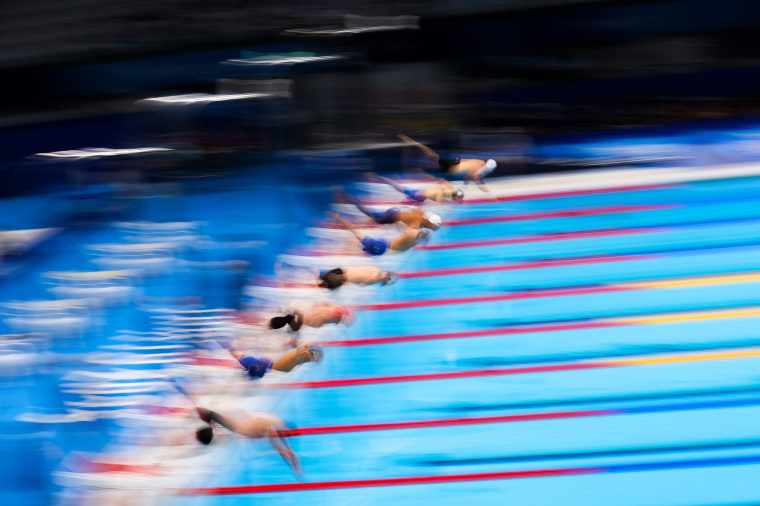 Competitors start during the Men's 100m Breaststroke Semifinal on day two of the Tokyo Games on July 25, 2021.