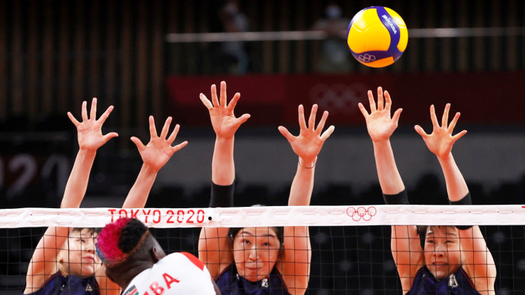 Kenya's Sharon Kiprono goes up against Japan's volleyball team at the Tokyo Games on July 25, 2021.