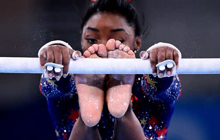 Simone Biles competes on the uneven bars at the Tokyo Games on July 25, 2021.