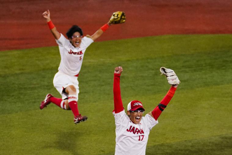 Japan's Yukiko Ueno, right, and Yu Yamamoto celebrate after winning softball game against the United States at the Olympics in Yokohama, Japan, on July 27, 2021.