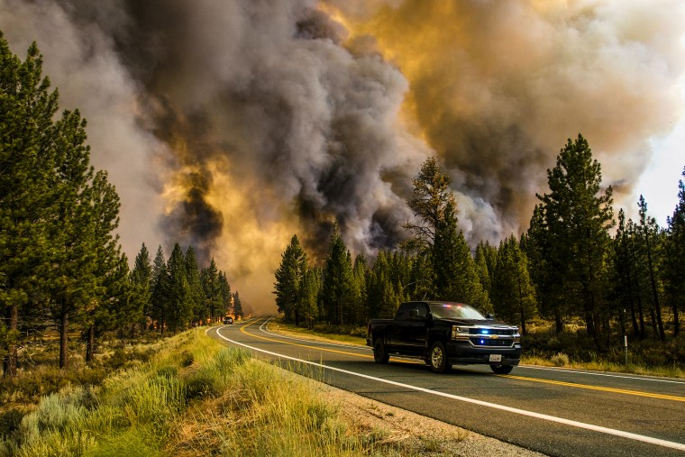 The Tamarack fire burns along the road in Markleeville, Calif., on July 17, 2021.