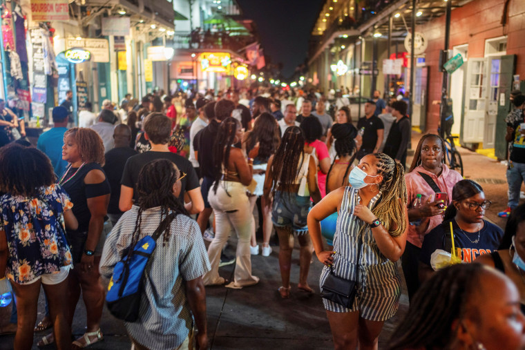 Image: Revelers crowd the French Quarter as Louisiana's COVID-19 cases rise amid Delta variant, in New Orleans