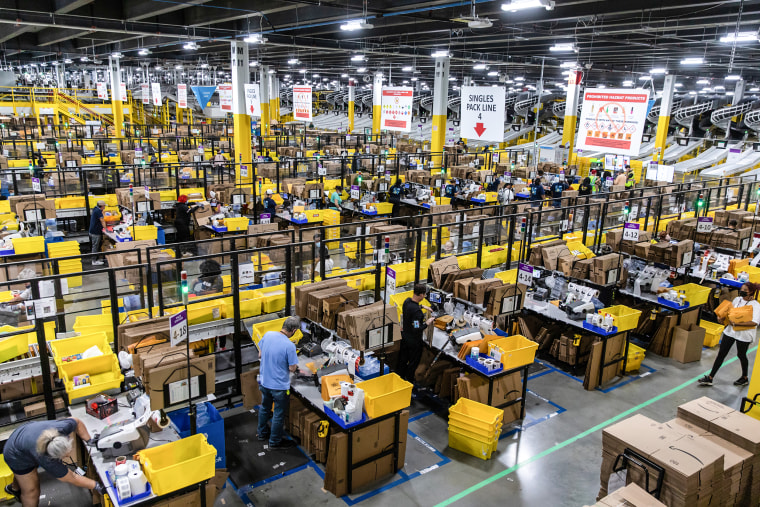 Workers fulfill orders at an Amazon fulfillment center on Prime Day in Raleigh, N.C., on June 21, 2021.