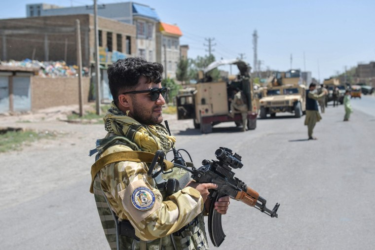 An Afghan National Army commando stands guard along the road in Enjil district of Herat province on Aug. 1, 2021, as skirmishes between Afghan National Army and Taliban continue.