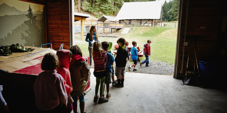 Summer camp students in line to go outside
