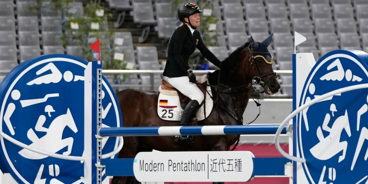Annika Schleu of Germany cries as she couldn't control her horse.
