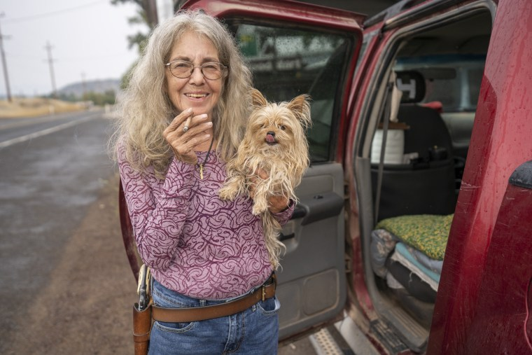 """Rita Nalette, a self-described \""""Mountain Woman,\"""" and her dog Baby, are living in her truck in Beatty, Oregon."""