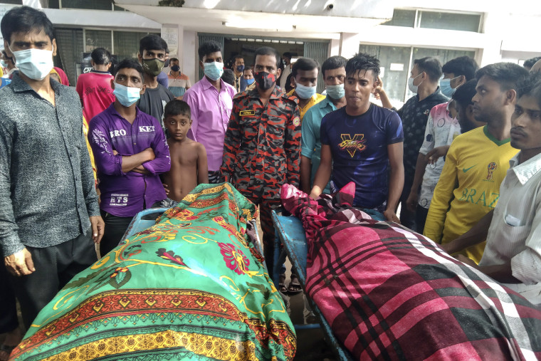 Image: People gather around bodies of victims after lightning killed more than a dozen people in Shibganj in Chapainawabganj district, about 150 miles northwest of Dhaka, Bangladesh, on Aug.4, 2021.