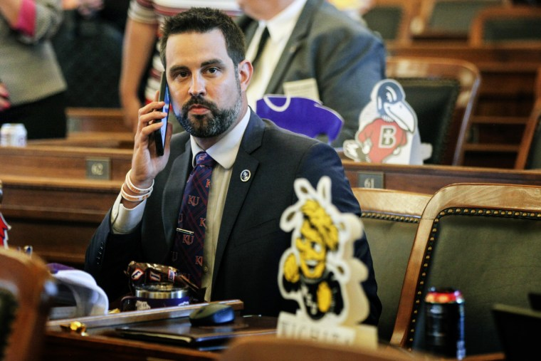 Kansas state Rep. Mark Samsel, R-Wellsville, talks on his cellphone ahead of the House's daily session, at the Statehouse in Topeka, Kan., on May 3, 2021.