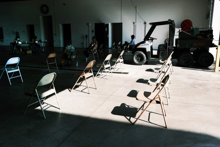 Image: Chairs sit empty among those waiting at a Covid vaccine clinic on Aug. 4, 2021 in Ferguson, Mo.