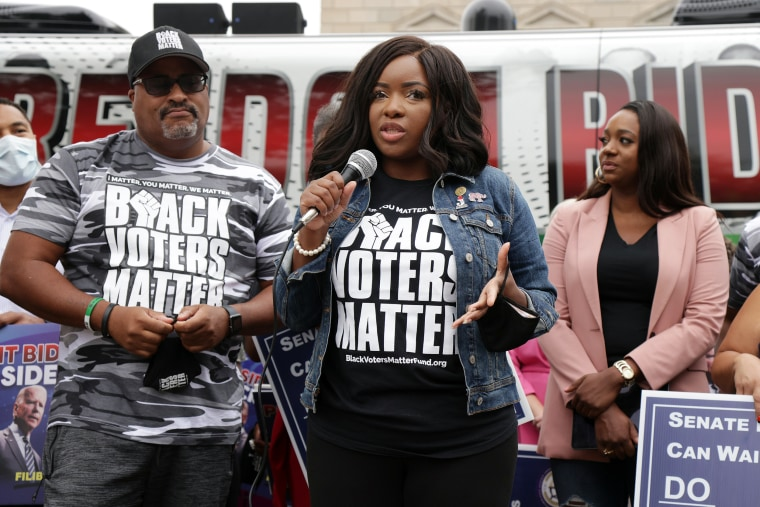 Image: Texas State Rep. Jasmine Crockett, center, at a demonstration on voting rights outside National Museum of African American History and Culture on Aug. 4, 2021 in Washington.