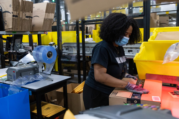Image: A worker assembles a box at an Amazon fulfillment center in Raleigh, N.C., on June 21, 2021.