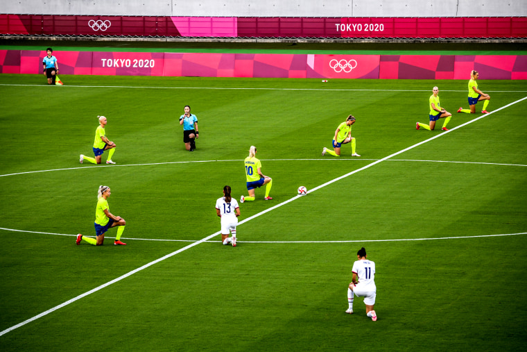 Players take the knee ahead of an opening round women's football match between the U.S. and Sweden at the Tokyo Olympic Game on July 21, 2021.