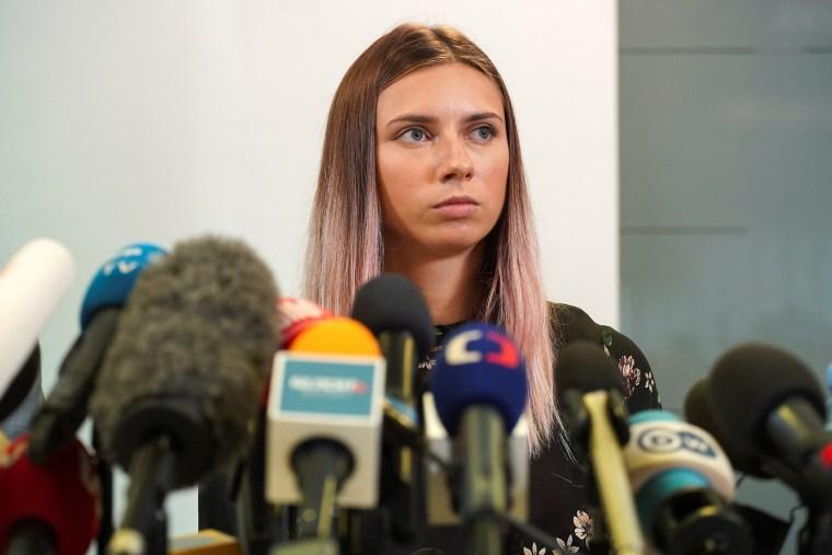 Image: Belarusian sprinter Krystsina Tsimanouskaya attends a news conference in Warsaw