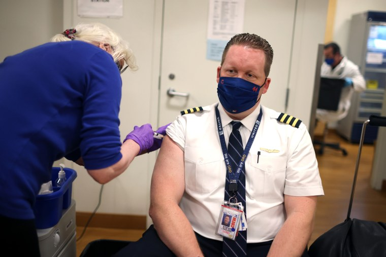 Image: United Airlines Employees Receive COVID-19 Vaccination At O'Hare Airport