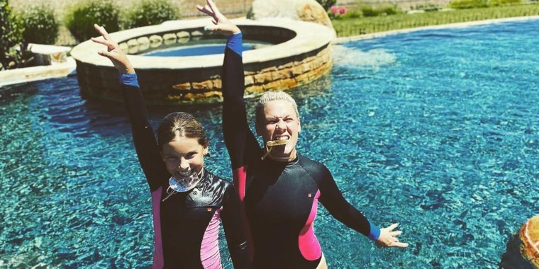 """Singer Pink and her 10-year-old daughter Willow had some fun in the pool while competing in their """"Family Olympics."""""""