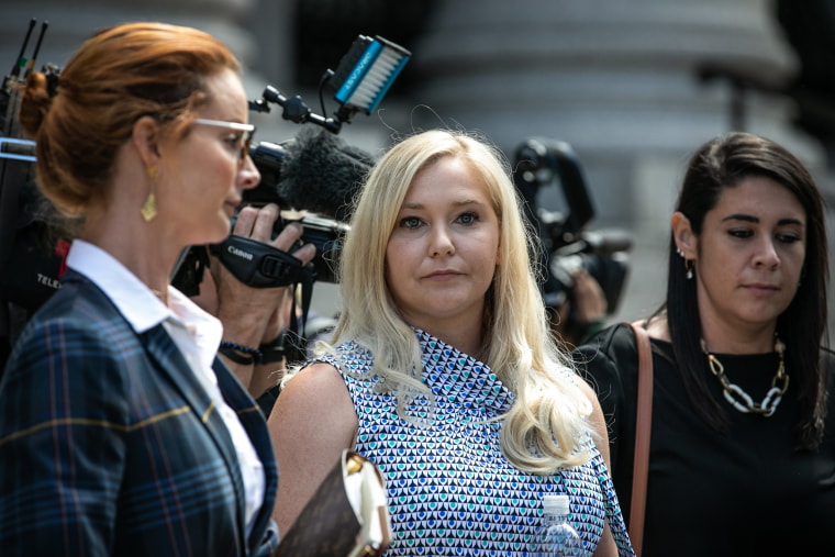 Virginia Giuffre, an alleged victim of Jeffrey Epstein, center, exits from federal court in New York on Aug. 27, 2019.