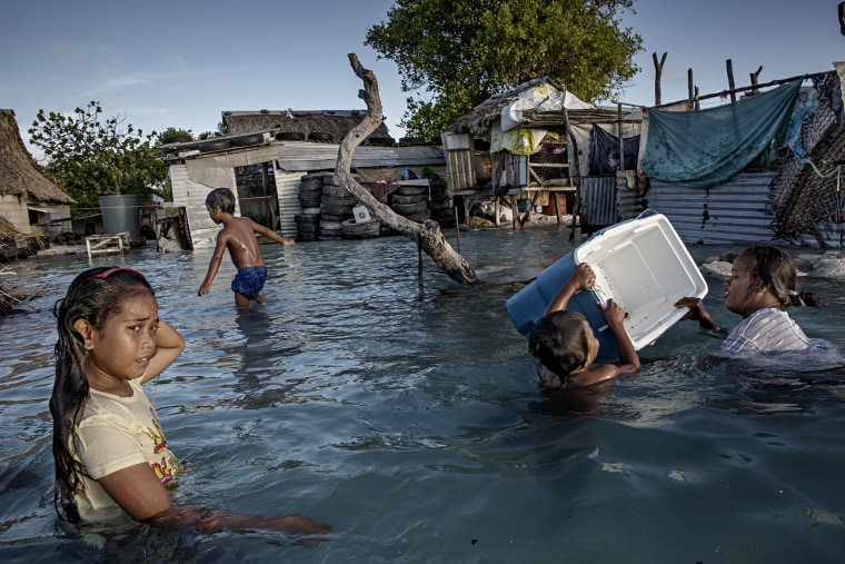 Image: Large parts of the village Eita has drowned in flooding from the sea, Kiribati.