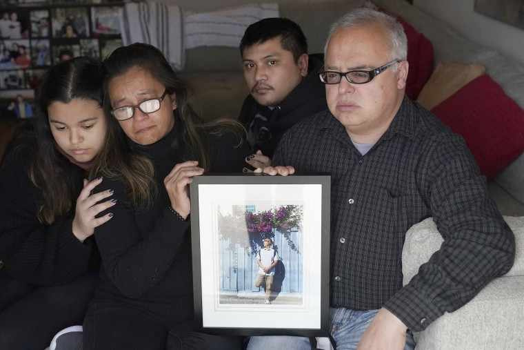 Image: Cassandra Quinto-Collins, second from left, holds a photo of her son, Angelo Quinto, during an interview in Antioch, Calif.