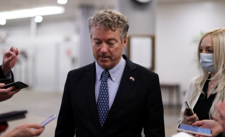 Image: Senator Rand Paul is trailed by reporters as he arrives at the U.S. Capitol in Washington.
