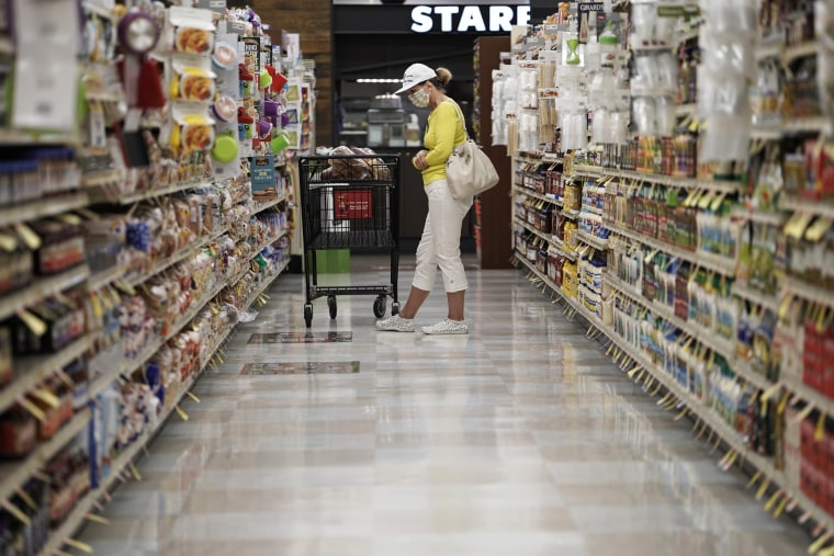 A customer shops at an Albertsons grocery store in San Diego, Calif., on June 22, 2020.