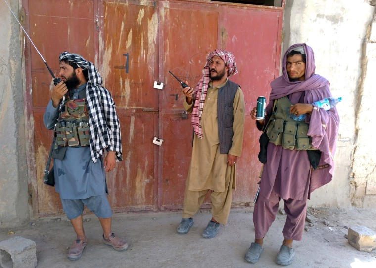 Image: Taliban fighters stand guard at a checkpoint in Farah, southwest Afghanistan, on Aug. 11, 2021.