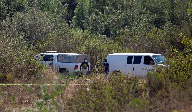Image: Forensic technicians work at the scene where two American children were found dead in Rosarito