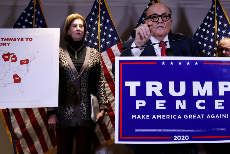 Image: Sidney Powell, an attorney later disavowed by the Trump campaign, participates in a news conference with President Donald Trump's personal lawyer Rudy Giuliani at the Republican National Committee headquarters on Capitol Hill