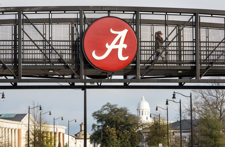 Image: A student walks over a footbridge connecting new residential buildings with the older part of campus at the University of Alabama in Tuscaloosa, Ala., on Jan. 15, 2016.