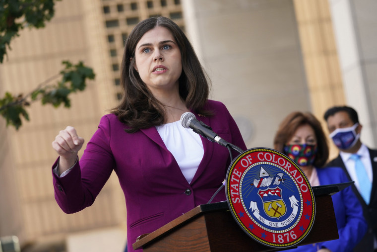 Image: Colorado Secretary of State Jena Griswold speaks during a news conference about the the state's efforts to protect the process of casting a vote in the general election in downtown Denver.