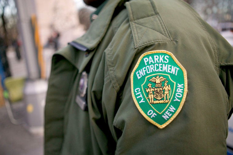 Badge of New York City Parks and Recreation enforcement department on security guard s arm USA 13 February 2005