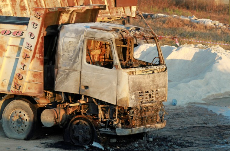 Image: A burnt truck is seen at the site of a fuel tank explosion in Akkar