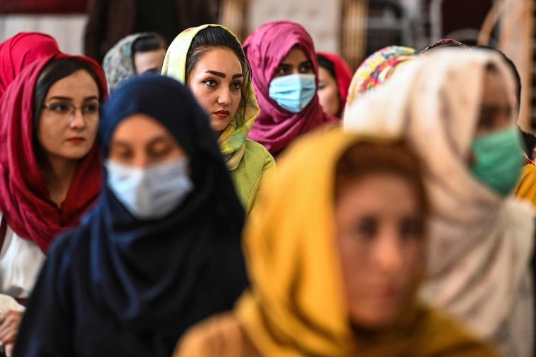 Image: Afghan women take part in a gathering at a hall in Kabul on Aug. 2, 2021 against the claimed human rights violations on women by the Taliban regime in Afghanistan.