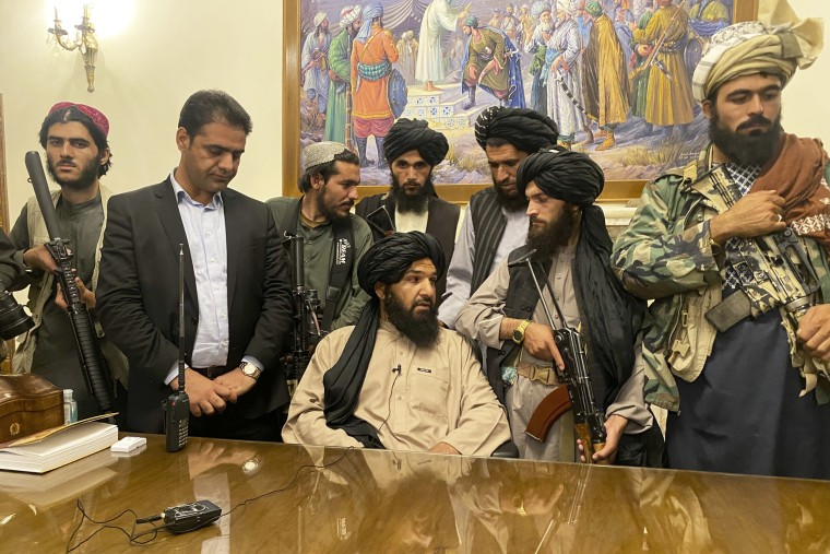 Taliban fighters take control of Afghan presidential palace after the Afghan President Ashraf Ghani fled the country in Kabul on Aug. 15, 2021.
