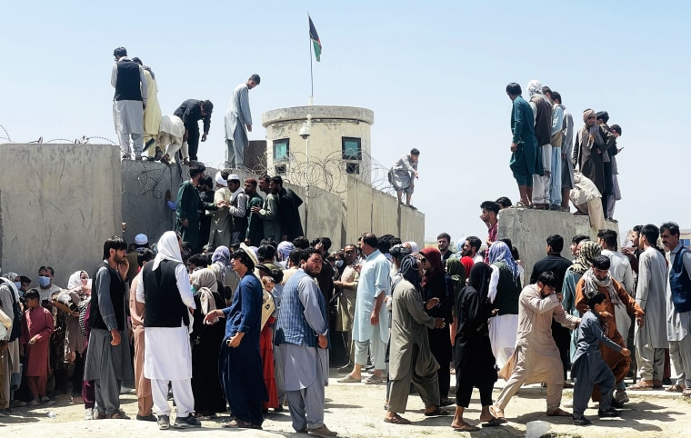 Thousands of Afghans rush to the Hamid Karzai International Airport as they try to flee Kabul on Aug. 16, 2021.