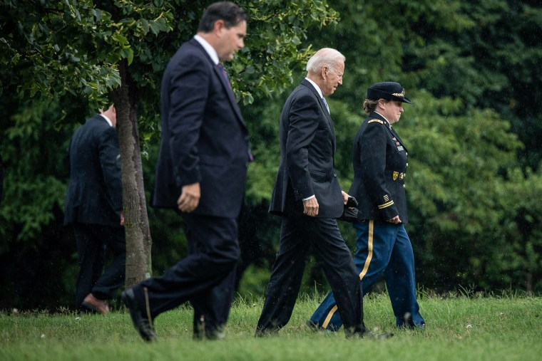 Image: President Joe Biden walks to Marine One at Fort McNair after returning to the White House on Aug. 16, 2021.