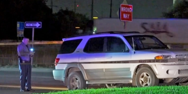 Police respond to an incident in which a driver was shot in Houston on Aug. 20, 2021.