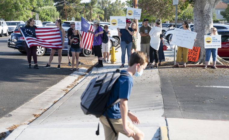 Protesters rallied against maks outside of Hewes Middle School in Tustin, Calif., on August 13, 2021, a day after a student refused to wear a face mask on the first day of school and was sent to wait outside the school's front office.