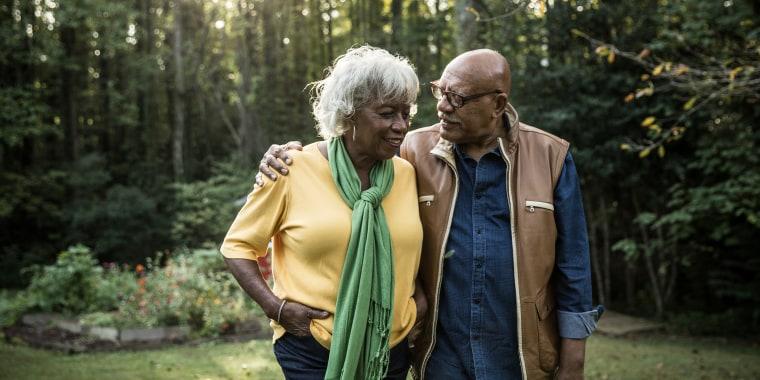 An older couple talking outside