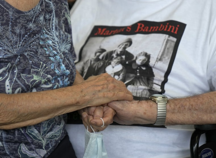 Image: 97 year old retired American soldier Martin Adler holds Giuliana Naldi's hand at Bologna airport